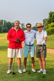 MIxed-Age Men's Golf Threesome Stock Images