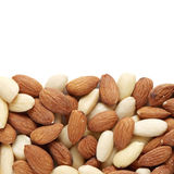 Almond nuts. Mixed almond nuts scattered on white background Stock Image