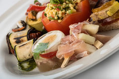Mixed appetizers with meat, egg and vegetables Royalty Free Stock Photography