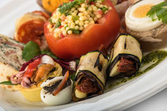 Mixed appetizers with meat, egg and vegetables Stock Photo