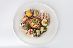 Mixed appetizers with meat, egg and vegetables Stock Photos