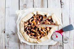 Mixed Apple and Berry Galette. Rustic apple and black currant pie galette with a buttery crust Royalty Free Stock Photography