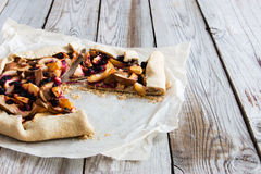 Mixed Apple and Berry Galette. Rustic apple and black currant pie galette with a buttery crust Royalty Free Stock Photos
