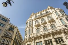 Beautiful modernist building from XX century in the city center of Malaga, Spain. Mixed architecture at the city center of the Andalusian city of Malaga, Spain royalty free stock images