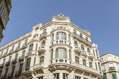 Beautiful modernist building from XX century in the city center of Malaga, Spain. Mixed architecture at the city center of the Andalusian city of Malaga, Spain stock photography