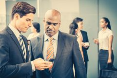Mixed Asian and Caucasian business team meeting royalty free stock photography