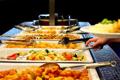 Mixed Asian food on plates. Mixed Asian food buffet and sushi Royalty Free Stock Photos