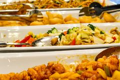 Mixed Asian food at the restaurant buffé. Mixed Asian food at restaurant buffé Close-ups of Asian food, buffet of various food, sushi, fried chicken royalty free stock photo