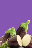 Mixed aubergines and a cut one Royalty Free Stock Images