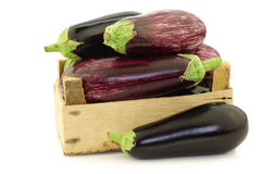 Mixed aubergines in a wooden crate Stock Photo