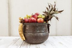 Mixed with autumn fruit in a metal pot Stock Photo