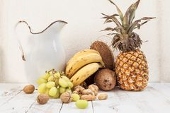 Mixed with autumn fruits and a pitcher Stock Photography
