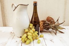 Mixed with autumn fruits and a pitcher Royalty Free Stock Image