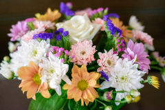 Mixed autumn tones floral arrangement with chrysanthemums and roses Stock Images