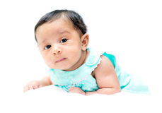 Mixed baby in teal shirt on white background looking at the came royalty free stock photos