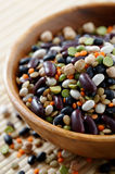 Mixed beans. Wooden bowl full of mixed beans Royalty Free Stock Images
