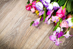 Mixed beautiful flowers on wooden background Stock Image