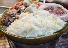 Mixed beef entrails ingredient food in bamboo basket on market Stock Photo