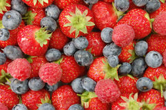 Mixed berries. Assorted ripe summer berries closeup stock photo