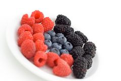 Mixed berries. On a plate stock photos