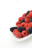 Mixed berries. On a plate stock photography