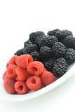 Mixed berries. On a plate royalty free stock photos
