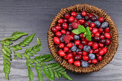 Mixed Berries. In a basket on green wooden background Stock Photography
