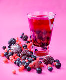 Mixed berries and berry juice Stock Photography