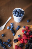 Mixed berries, blueberry, raspberry. On the kitchen, mixed berries, blueberry, raspberry, food ingredients, on the table, process of cooking, beautiful Stock Photos
