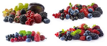 Mixed berries and fruits with copy space for text. Set of fresh fruits and berries isolated a white background. Ripe blueberries,. Blackberries, currants Royalty Free Stock Images