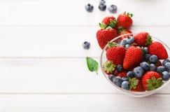 Mixed berries in glass bowls closeup Stock Photos