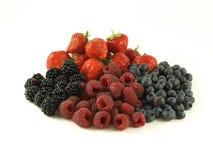 Mixed berries, isolated. Berries - blackberries, raspberries, strawberries, blueberries on isolated background royalty free stock photo