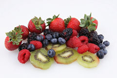 Mixed berries with kiwi Stock Photography