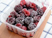Mixed berries in plastic box Stock Photography