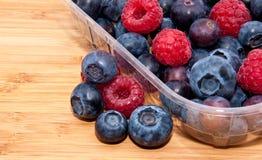 Mixed berries in plastic box - macro view Royalty Free Stock Photo