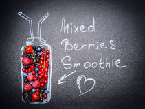 Mixed Berries Smoothie lettering. Various  fresh berries and painted Bottle with drinking straw Royalty Free Stock Image