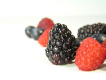 Mixed berries on white stock photos
