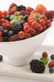 Mixed berries in a white bowl. Royalty Free Stock Image
