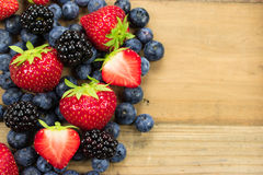Mixed berries on wood Royalty Free Stock Photo