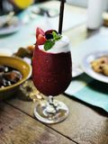 Mixed berries yogurt smoothie. A glass of mixed berries yogurt smoothie royalty free stock photo