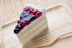 Mixed berry cheese cake with wooden plate Royalty Free Stock Images