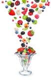 Mixed berry falls into the ramekin with berry salad Stock Photos