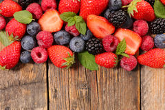 Mixed berry fruit. On wood background royalty free stock photos
