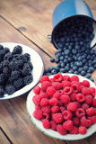 Mixed berry fruits. On table Royalty Free Stock Photography