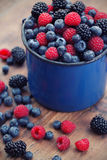 Mixed berry fruits. On table Stock Image