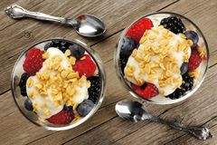 Mixed berry granola and yogurt parfaits above view Stock Photography