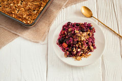 Mixed berry and rhubarb crumble Stock Photo