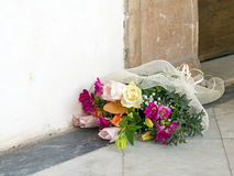 Mixed bouquet by doorway. Jilted bride maybe? Stock Photo