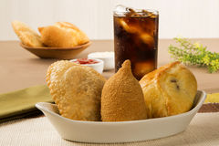 Mixed Brazilian deep fried chicken snack,, esfihas and pastry. Royalty Free Stock Image