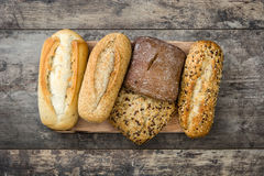 Mixed bread on wooden table. Stock Photo